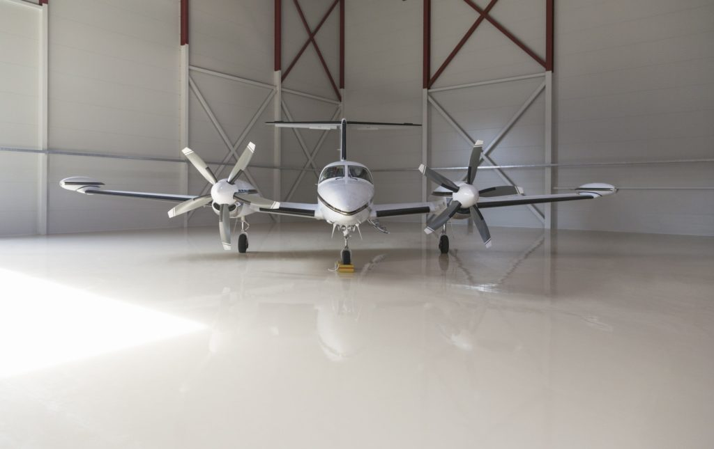 Small aircraft parked in a hangar