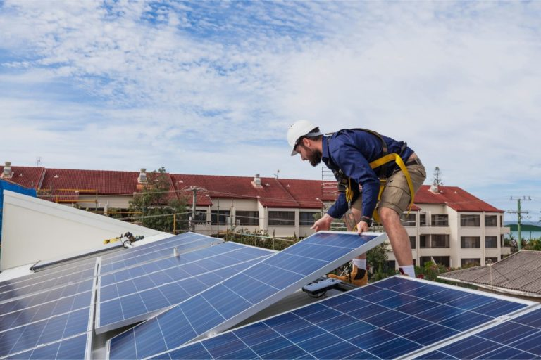 Working installing commercial solar power panels