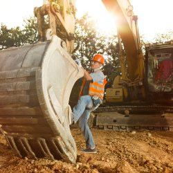repairman fixing excavator